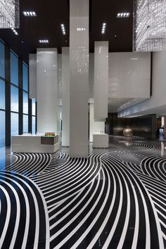 The striped floor of the Mandarin Oriental Hotel in Guangzhou #graphic #interior #stripes #bandw - Carefully selected by GORGONIA www.gorgonia.it