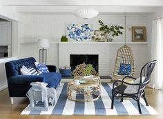 White modern living room with simple fireplace and blue accents by Emily Henderson www.pencilshavingsstudio.com