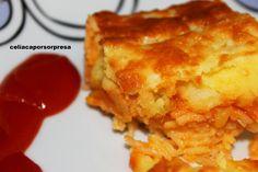 ♥ pastel de arroz, calabacín y puré de patata (horno) / 5 patatas medianas  - 10 cucharadas de arroz basmati  - 1 calabacín grande  - agua  - 2 huevos  - 1 brick de  tomate frito sin gluten (Cidacos – Hacendado)  - sal  - margarina de maíz apta (Artua)  - aceite de oliva  - queso rallado para gratinar