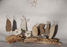 Wire and paper nativity on driftwood?