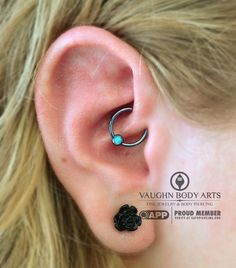 Katherine stopped in for a daith piercing (our favorite). She chose this gorgeous anatometalcaptive bead ring with a light blue opal, anodized ice blue in house. Thanks so much Katherine!