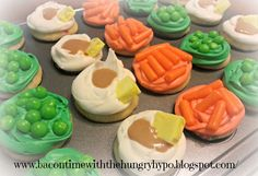 Easy cupcakes decorated with candy to look like peas, carrots, and mashed potatoes with butter and gravy.