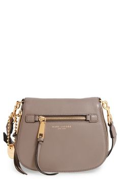 Free shipping and returns on MARC JACOBS 'Small Recruit' Pebbled Leather Crossbody Bag at Nordstrom.com. A sized-down crossbody in a chic saddle-bag silhouette features an array of pockets and card slots, including a zip-around flap pocket that nearly doubles the bag's capacity. Tasseled zipper pulls and chunky gilded hardware polish the look.