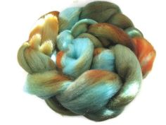 It's back!  Hand Dyed Roving  - Turquoise, Orange, Brown, Rust. $16.00, via Etsy.