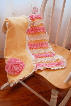 jersey/t-shirt ruffle blanket.  i would probably do the ruffles sewn onto cotton instead of jersey.