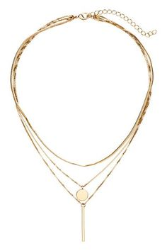Collier constitué de trois fines chaînes en métal avec pendentif. Longueur réglable, 38-46 cm.