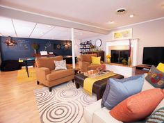 This cheery basement offers something for the whole family. On this side of the open floor plan there's a stylish sitting area where adults can relax.