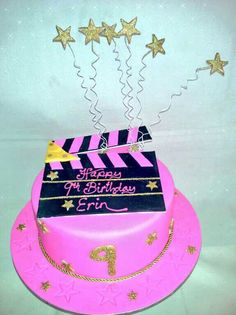 Pink n gold themed movie clapper cake