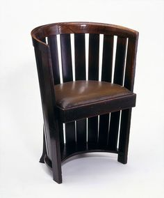 Chair   Place of origin:  Glasgow, Scotland (manufactured)    Date:  ca. 1907 (designed)   ca. 1907 (made)    Artist/Maker:  Mackintosh, Charles Rennie, born 1868 - died 1928 (designer)   Smith, Francis (probably, maker)    Materials and Techniques:  Stained oak, with synthetic leather seat and iron covers on rear feet