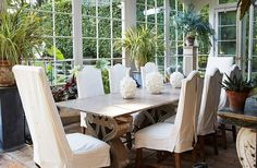 The very sociable Bunny and John host many dinner parties in the conservatory. The tabletop and the bases are made of stone; the ceramic gourds are by Christopher Spitzmiller.