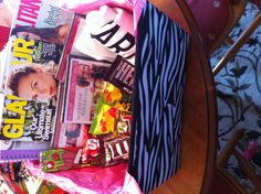 Girls birthday gift: magazines, DVDs, candy, and a tshirt in a cute zebra print bin!