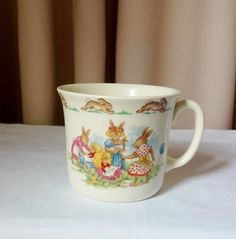 Check out this item in my Etsy shop https://www.etsy.com/au/listing/270056581/childs-single-handle-mug-bunnykins-royal
