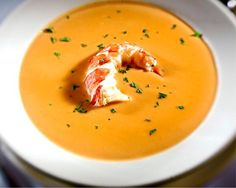 It's Julia Child. This ultimate recipe for classic French lobster bisque cannot possibly be improved upon.     Well...maybe a bit. ;)     I've slightly tweaked the recipe and steps as outlined at http://mainelylobster.bangordailynews.com/2015/02/02/home/julia-childs-lobster-bisque/ :)    Battle on - The