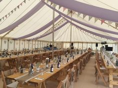 Our stunning natural marquee with rustic trestle tables ~ perfect for a vintage feel wedding