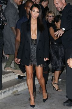 At the Lanvin show with Kanye West during Paris Fashion Week.
