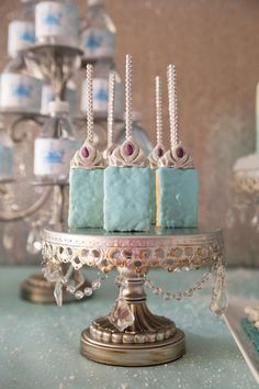 Gorgeous White Chocolate Covered Rice Krispie Treats for a Frozen Party