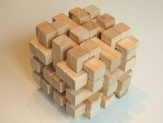 An interesting puzzle that you can build. It's found here- http://woodgears.ca/puzzles/36-piece.html