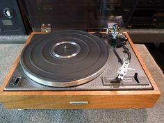 "Pioneer PL-12D ""Silver vein"" restored 1973 turntable with ""Silver Vein"" powder coasted top deck and real wood mahogany wood veneer base."