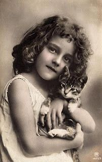 vintage b/w photo girl and cat and like OMG! get some yourself some pawtastic adorable cat shirts, cat socks, and other cat apparel by tapping the pin!
