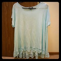 Light blue flowy tshirt Light and flowy fit light blue T-shirt. Never worn! Fits big :) Freshman Tops Tees - Short Sleeve