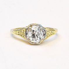 Stunning and intricately detailed, this wonderful antique 1920s engagement ring is a true work of art. The craftsmanship along the buttery yellow