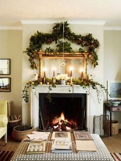 Holiday decorated fireplace.  Home Decor Inspiration home decor, home inspiration, furniture, lounges, decor, bedroom, decoration ideas, home furnishing, inspiring homes, decor inspiration. Modern design. Minimalist decor. White walls. Marble countertops, marble kitchen, marble table. Contemporary design. Mid-century modern design. Modern rustic. Wood accents. Subway tile. Moroccan rug.
