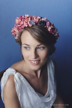 Pastel pinks and purple-blue flowers make a lovely autumnal flower crown for a Fall wedding