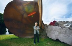 """Anish Kapoor with """"Dirty Corner"""", the imposing sculpture in Versaille's gardens. Photo: Jacques Grad via Le Jdd"""