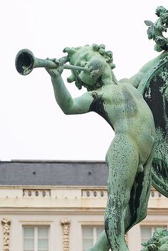 cherub with horn by ice.in.the.cider, via Flickr