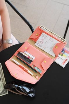 All-in-One Leather Pop Clutch. This would be great for travel!