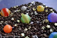 """Coffee Beans """"Space"""" Sensory Bin + 40 Days of Sensory Bin Fillers Sensory Table, Sensory Bins, Sensory Play, Kids Learning Activities, Home Learning, Sensory Activities, Tot Trays, Dark Brown Color, Earth From Space"""