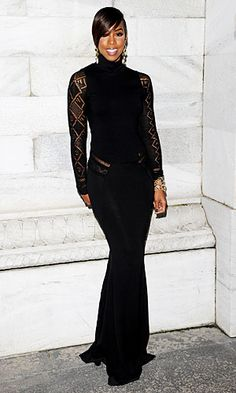#Kelly_Rowland wore a black #Roberto_Cavalli gown for the designer's fall fashion show.