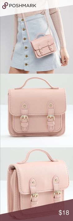 "ASOS Pink Mini Satchel Crossbody Bag Like-new condition, only used 1-2 times. This is a small bag (about 6"" x 5.25"") that is perfect for carrying the essentials. There is one main pocket and one smaller front pocket. There is no zipper pocket on the inside. The bag closes via a magnetic clasp. The material is a very nice soft faux leather. The last photo is of the actual product, however the stock photos are most true to color. ASOS Bags Crossbody Bags"