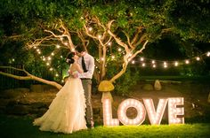 DIY Marquee Letters // Love the look; love using marquee letters at a wedding; holy crap that looks like a huge project. Good thing you can find these pre-made on Etsy! Wedding Reception Lighting, Marquee Wedding, Wedding Signs, Diy Wedding, Rustic Wedding, Wedding Photos, Wedding Day, Wedding Favors, Wedding Sparklers