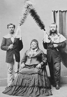 Her Highness, Ruth Luka Keanolani Kauanahoahoa Keʻelikōlani of Hawaii with hapa-haole chiefs Samuel Parker and John Adams Cummins as kāhili bearers.