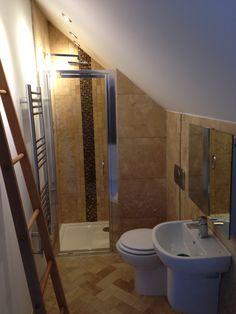 Loft conversion master en-suite.  Travertine mix.  Glass mosaic feature in shower #sdbtilingltd
