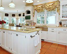 NB KITCHEN - yellow countertop, white cabinets, terracotta/saltillo tile floor