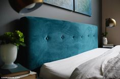 If you're in a crafty mood to create some trendy home decor, follow our tutorial to make this gorgeous DIY velvet headboard for less than $100!