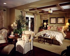 Feminine master bedroom design with floral billows and art