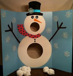 "MR. SINGING SNOWMAN & POM-POM SNOWBALLS. Fun Christmas party game.  -- Change it up with a HP theme.  Having kids throw silver ""Patronus"" balls at  adementor ""Expecto Patronum!"""