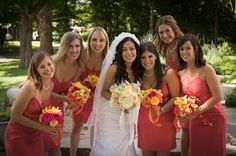 These coral dresses were paired with bouquets of pinks, corals and bright yellows.  The bride carried a muted version.  Parker wedding, Colgate University.  Photo by John Seakwood.