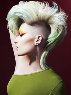 A bird-of-paradise style creative-color mohawk from Hooker & Young's Heroes Collection. https://industrieonline.com/heroes-hooker-young/?utm_campaign=coschedule&utm_source=pinterest&utm_medium=Industrie&utm_content=Heroes%20from%20Hooker%20and%20Young