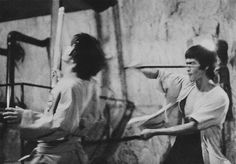 Bruce behind the scenes, rehearsing fight scenes for Enter the dragon.