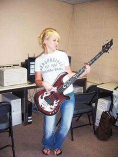 Never thought I would find a picture of Jen playing the guitar wearing Aeropostale and jeans