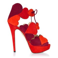 Charlotte Olympia. Fall gracefully Head Over Heels for this outstanding platform sandal. Luscious tones of red suede hearts embrace the foot and tie together with two delicate leather laces, creating a chic and sultry silhouette.