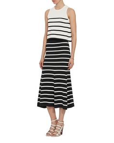 Cardigan EXCLUSIVE Striped Knit Tank: An A-line crop sleeveless knit silhouette. In white/black stripe. Fabric: 67% cotton/33% polyamide Made in China. Model Measurements: Height 5'10 1/2; Waist 24 ; Bust 31 wearing size S   Length from shoulder to hem: ...