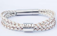Triple braided leather wrap bracelet and pure silver personalised bead or beads . The clasp we use is stainless steel with a snap close mechanism , to ensure safety of your treasured beads. Please choose how many lines you would like on the bead ( ie name and date bead would be two lines ) , from the options . Each line can fit approx 8/9 maximum characters . The more names the bigger the bead - there is also the option of having two beads . Please see photos . * If you would like the t...