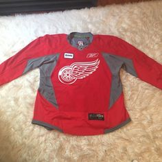 Reebok Redwings practice jersey This is an authentic Red Wings practice jersey made by reebok. Makes a great present for your man who is a hockey fan! Size 54. Which is a XL Reebok Other