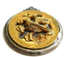 Antique brass button dating back to the 1800's