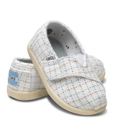 It's as easy to slip this shoe on little feet as it is to make a big difference. TOMS' classic styling with its toe-stitch and elastic V goring gets kid-size perks like a cool print, a flexible rubber cupsole and an adjustable strap for the perfect, snug fit. And with every pair of TOMS shoes purchased, another pair is given to a child in need.Size note: TOMS run true to size. I...